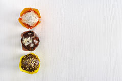 The background is wooden in white with three different muffins. Stock Photography