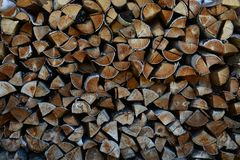 Woodpale from choped logs. Background of woodpale. Texture of crafted logs Stock Images