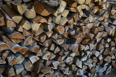 Woodpale from choped logs. Background of woodpale. Texture of crafted logs Stock Image