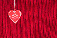 Background of wool knitted fabric with heart Royalty Free Stock Image