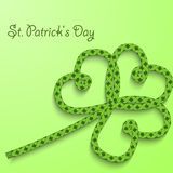 Background with the words St. Patricks Day. Clover with three petals of green folded rope. Stock Images