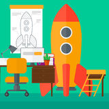 Background of workspace with business start-up rocket. Stock Photo