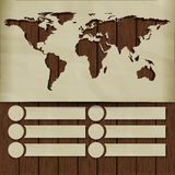 Background world map carved in the paper on wooden boards Royalty Free Stock Photo