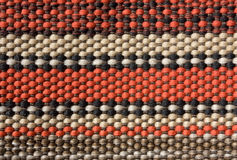 Background of woven  carpet. Colored striped carpet - macro photo Stock Images