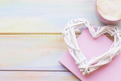 Background with a woven heart and coffee stock photo