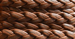 Background of a woven leather strap close-up.  Royalty Free Stock Photos