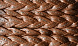 Background of a woven leather strap close-up.  Stock Photos
