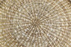 Background - a woven spiral circle with a straw texture. Stock Photography