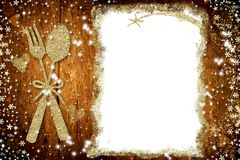 Background for write Christmas menu. White empty parchment, golden spoon and fork freehand drawn on old wooden background Stock Images