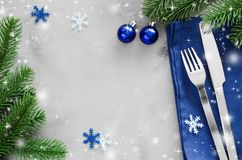 Background for Writing the Christmas Menu. Winter Table Setting. Christmas tree, cutlery and blank paper. Top View, Copy Space stock photography