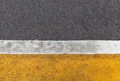 Background of yellow black strips . Dark grey asphalt road dividBackground of yellow black strips . Dark grey asphalt road divided. Background of yellow black stock image