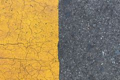 Background of yellow black strips . Dark grey asphalt road divided by yellow pain. T. yellow black background stock photography