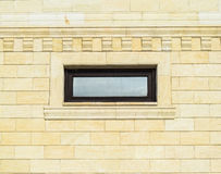 Background of yellow brick and windows. Wall of yellow bricks with a plastic window. The texture of the wall.  Stock Photo