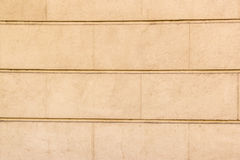 Background with yellow concrete wall in big bricks. Part of wall as background royalty free stock images