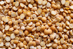 Background of yellow dried split peas. Royalty Free Stock Images