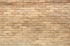 Background of yellow facing bricks. Bricks relief close up.  Royalty Free Stock Photos