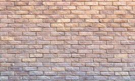Background of yellow facing bricks. Bricks relief close up.  Stock Photo