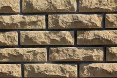 Background of yellow facing bricks. Close up. Background of yellow facing bricks. Bricks relief close up Stock Image