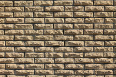 Background of yellow facing bricks. Stock Image