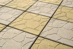 Background with yellow and gray paving slabs stock photos