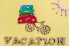 Background yellow, image of heap of suitcases on bicycle Royalty Free Stock Photos
