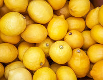 Background of yellow lemons. Royalty Free Stock Photo