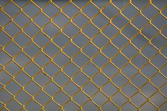 Background of yellow metal mesh Royalty Free Stock Images