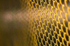 Background of yellow metal mesh Stock Image