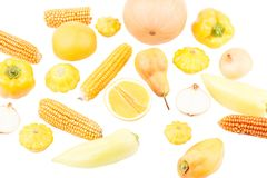 Background from yellow and orange fresh raw vegetables and fruits, isolated. Top view Royalty Free Stock Photo