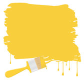 Background with yellow paintbrush Stock Photo