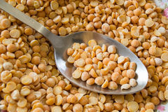 Background yellow peas with an iron spoon. Photo background yellow peas with an iron spoon Stock Photo