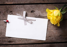 Background with yellow rose and empty tag Stock Image