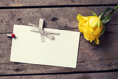 Background with yellow rose and empty tag Stock Images