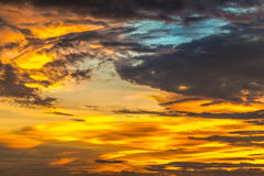 Background of yellow sky with clouds at sunset Stock Images