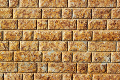 Background of yellow stone slabs wall Royalty Free Stock Image