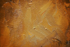 Background yellow terra-cotta. Dab brown, yellow, terra-cotta paint on canvas royalty free stock images