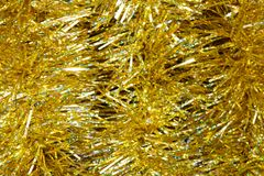 Background of yellow tinsel. Christmas background of yellow tinsel Stock Images