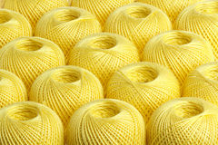 Background yellow yarn. Texture of colored yarn skeins royalty free stock images