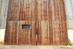 Background: zinc entrance of old factory Stock Images