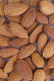 Backgrounds of almonds. Backgrounds of roasted and salted almonds Royalty Free Stock Photos