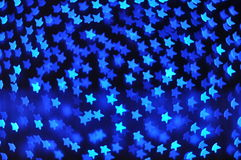 Backgrounds with blue stars lights Royalty Free Stock Photos