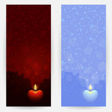 Backgrounds with burning heart-shaped candles Royalty Free Stock Photo