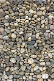 Backgrounds collection - Wall built of sea pebbles Royalty Free Stock Photo