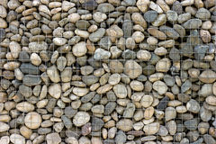 Backgrounds collection - Wall built of sea pebbles Royalty Free Stock Image