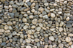Backgrounds collection - Wall built of sea pebbles Stock Images