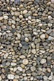Backgrounds collection - Wall built of sea pebbles Royalty Free Stock Images