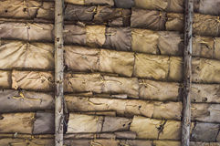 Backgrounds of dry leaves. Wall built from weave to dry leaves Stock Photography