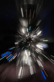 Backgrounds explosion effect of zoom blur lights desaturated. On dark background Royalty Free Stock Images
