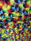 Backgrounds multicolors textured umbrellas day no people outdoors illuminated. Umbrellas multicolors textured backgrounds travel summer shadow outdoors Royalty Free Stock Photography