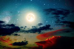 Backgrounds night sky. With stars and moon and clouds. wood. Elements of this image furnished by NASA Stock Photo